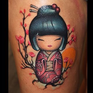 kokeshi tattoo - I think I'm gonna have to have oriental blossom added to that design of mine