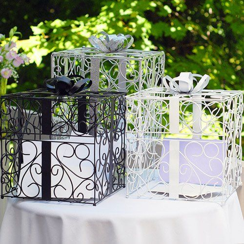 Just as your wedding dress isn't 'just' a dress, this ornate metal reception card box isn't 'just' a box. Incredible attention to detail makes this eye-catching wedding card holder a gorgeously chic table accessory. Whether you're looking for a practical bridal shower gift or a chic wedding decoration to wow your guests, this wedding card …