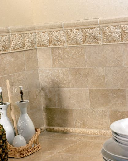 A Cast Stone Border Mimics The Look Of The Real Travertine