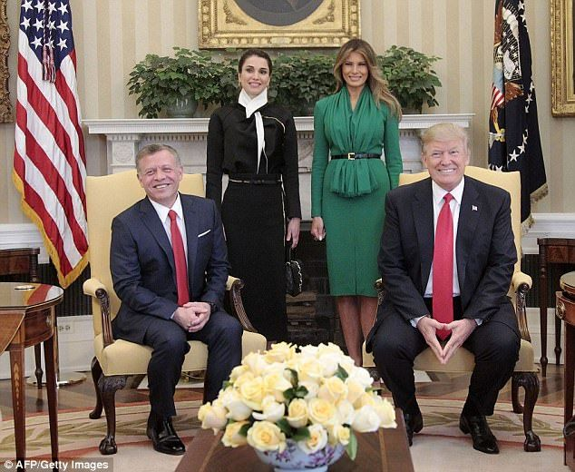 All smiles: The two women stood behind their respective husbands as they posed for photos in the Oval Office