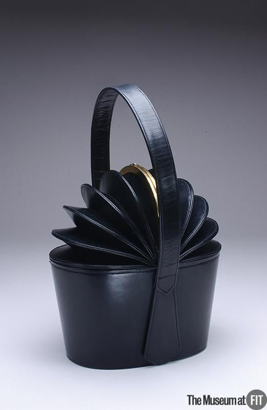 1949 Bogan black leather bag with gold tone metal.