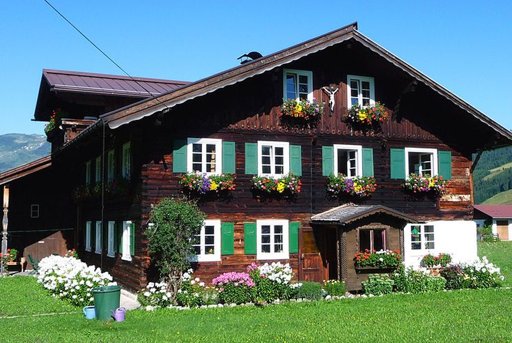 Austrian Houses - I love how they put the flowers on their windowsills!