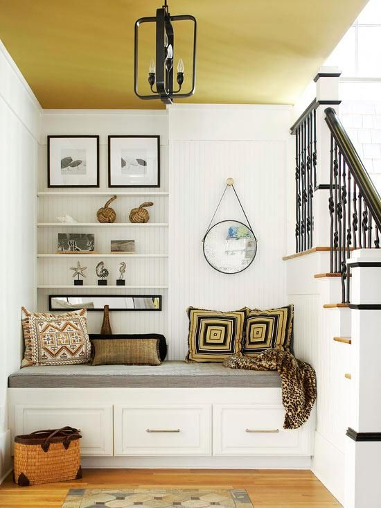 Both decorative and functional, this entryway banquette offers a spot to sit when putting on or taking off shoes or boots, as well as three drawers for storing all your front-entry necessities. It also teases with a tantalizing taste of the home's decor.