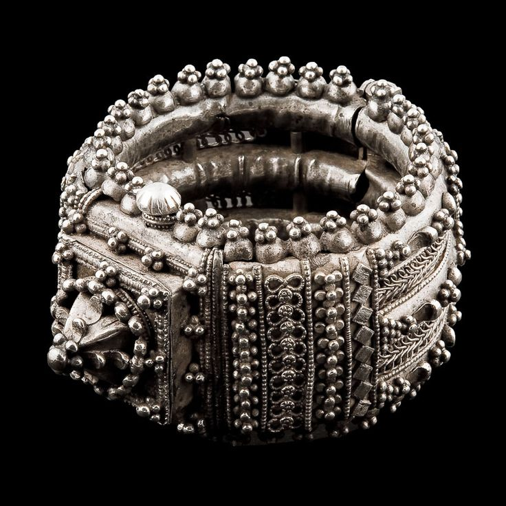 One look at this feminine cuff tells you that it was created for a truly beautiful woman. Unfasten the hinge, thread it onto your wrist or arm and become part of its 100-year history. Row after row of tactile pattern - with a magnificent centrepiece - conveys a message of sensuality. This bracelet's astonishing level of intricate detail makes it a piece to treasure forever. |Silver Bracelet| Orissa| India| Circa 1910| Wrist Dia 6cm| Height 10.5cm| 250g| £1200. www.rabari.co.uk