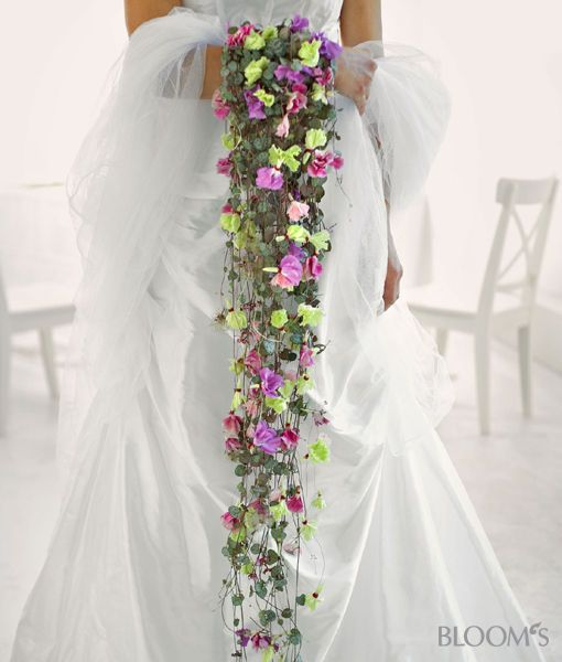 That's a waterfall bouquet! Made of pinks and Hearts on a String (Ceropegia linearis ssp. woodii)