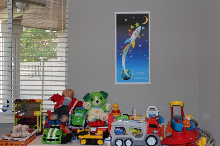 Rocket To The Moon hanging in a kids toy room. Personalization options available on our website.