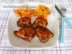 ballı limonlu tavuk but tarifi - Malzemeler: 10 adet derisiz-kemiksiz tavuk but, 1 yemek kaşığı tereyağ, 3 diş sarımsak, Tuz, Karabiber.