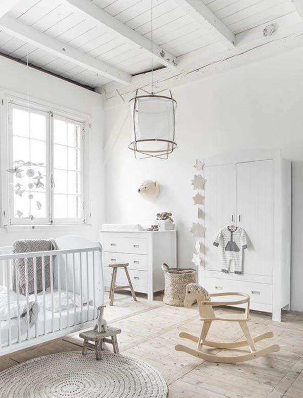 A simple white and wood nursery
