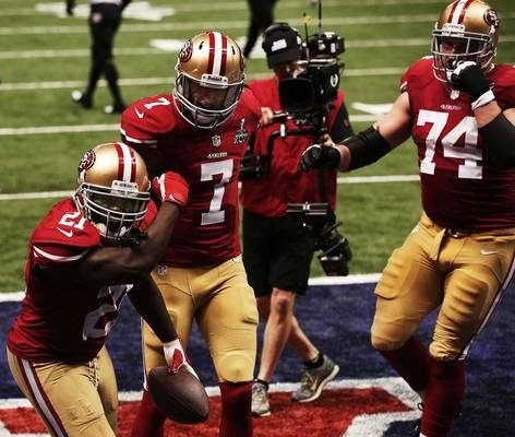 """Images from Super Bowl XLVII(87 images)  Updated Feb 4, 2013 3:18 AM ET  Kaepernicking Frank Gore (21) does the """"Kaepernicking"""" celebration made famous by his quarterback after scoring a touchdown in the third quarter.    Win McNamee - Getty Images"""