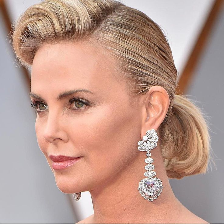 """Everything you need to know about Charlize Theron 's 59.9 carat (!!) #Oscars earrings: The first thing we thought when we saw Charlize Theron's earrings at the 2017 Oscars was, """"There's no way those could be real."""" Oh, but they are. 