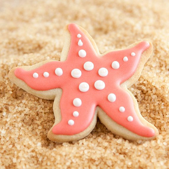 Perfect for any beach-themed sea side, under the sea, or mermaid birthday, these star fish cookies make a cute-and-casual statement!