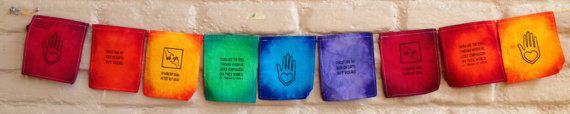 Teresa of Aliva Prayer Flags. 100% proceeds from this sale for charity.  These flags are part of a community development project supporting women and families in Juarez, Mexico, a city ravaged by drug wars and violent crime. $18