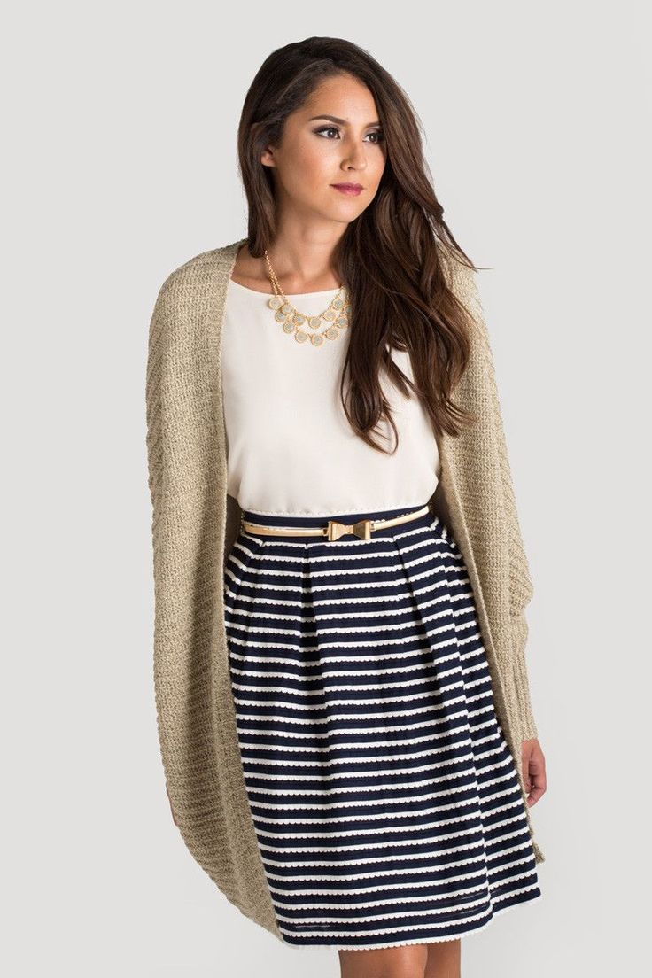 This striped skirt is the perfect combo of navy and white! The scallop detailed stripes make this the ultimate girly and chic piece! 60% Polyester. 30% Cotton. 10% SDY. Zipper side with hook and eye e
