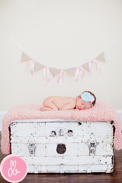 Newborn photo | Drew B Photography- maybe not naked, but I like the vintage chest idea :)