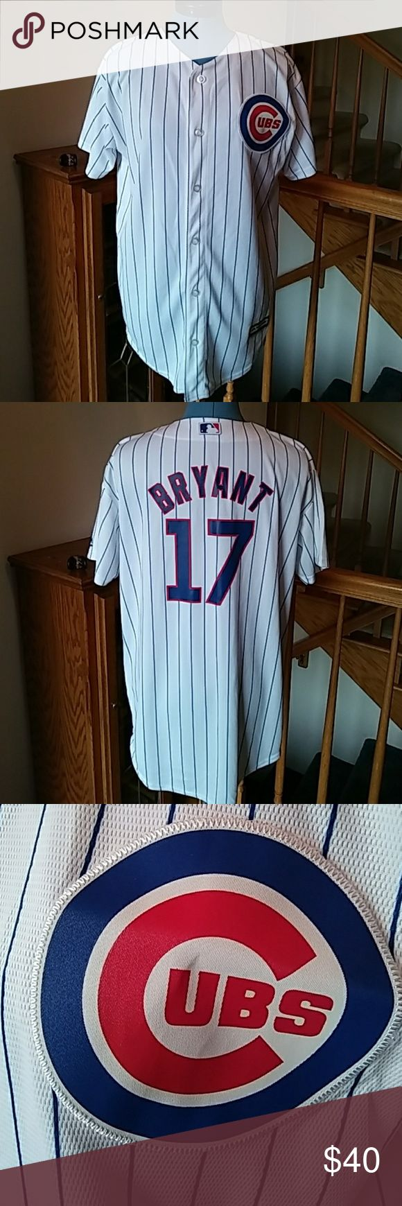 """Majestic Kris Bryant Cubs Jersey Youth XL Nearly new Cubs jersey, only worn once. Youth size XL, which is veeery generous. I'm 5'2"""" and this jersey comes down to mid-thigh on me. Logo Patch is sewn on, name and number are printed on. Go Cubs Go! Majestic Tops Tees - Short Sleeve"""