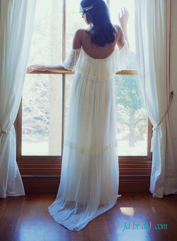 Ethereal flowy light bohemian beach destination wedding dress