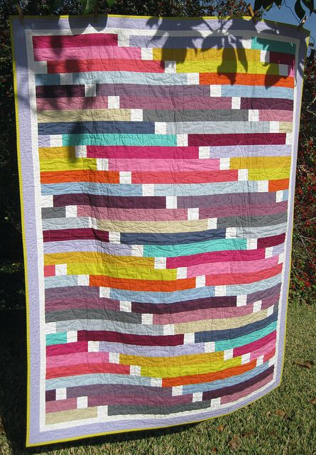 Beautiful strip quilt!! I love this. Directions given.