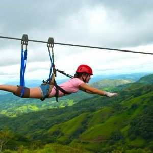 Zip lining in Costa Rica, scary but WAY fun.... Supermanning over the forrest — actually did this this summer but it was in the Philippines! also over forests and mountains and superman style! :)