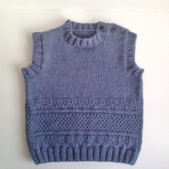 BLUE colour handknitted baby vest made from 50 % wool and 50% acrylic yarn and is ready to ship.  GREY colour handknitted baby vest. Soft and very warm, made from 100% wool. Suitable for both girls and boys. Made to order.  Hand wash or gentle machine wash cycle. Do dot bleach or hang. Dry flat.    Sizes to order : newborn, 0-24 months. IT WOULD TAKE 1-2 WEEKS TO FULFILL YOUR ORDER.  All items are made in a smoke and pet free home with care and love.