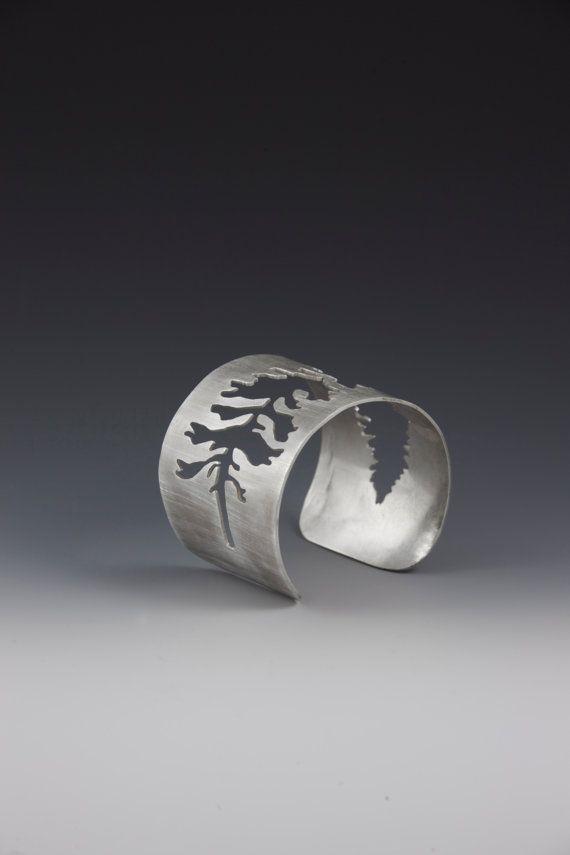 Hand pierced sterling silver cuff - Eastern White Spruce. Art jewelry by Miranda Britton