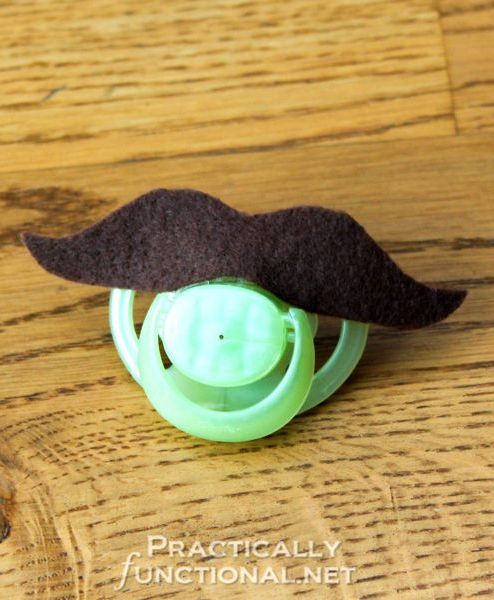 DIY Mustache Pacifiers: 10 minute baby shower gift! Made this for my friend's baby shower. It was a hit...and so hilarious