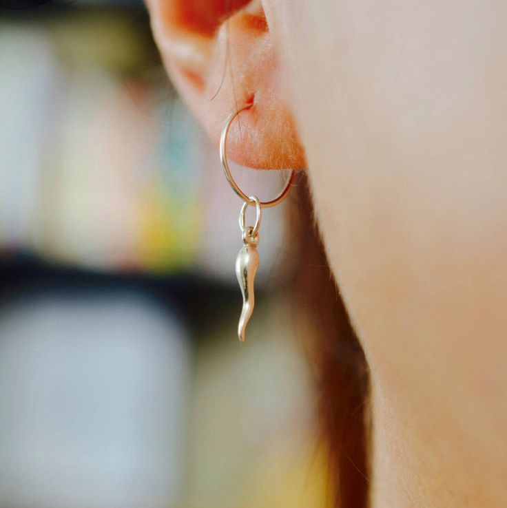 A personal favorite from my Etsy shop https://www.etsy.com/listing/289051039/small-italian-horn-hoop-earring-small