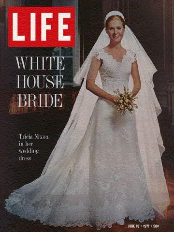 Tricia Nixon Cox posing in her Priscilla of Boston wedding gown on the cover of LIFE magazine in 1971.