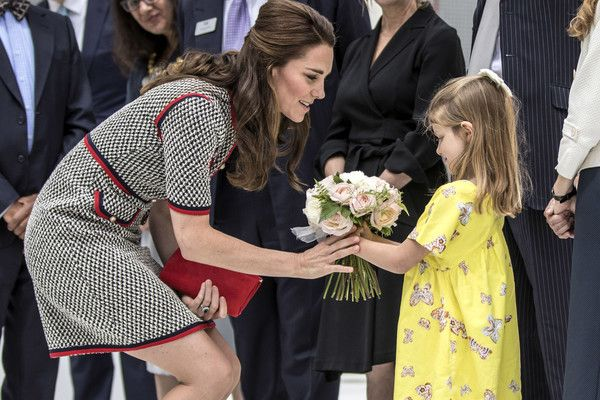 Kate Middleton Photos Photos - Catherine, Duchess of Cambridge receives flowers from six year old Lydia Hunt the daughter of new director of the V&A museum and former Labour MP Tristram Hunt at Victoria & Albert Museum on June 29, 2017 in London, England.  The V&A Exhibition Road Quarter was designed by British Architect Amanda Levete. - The Duchess Of Cambridge Visits The New V&A Exhibition Road Quarter