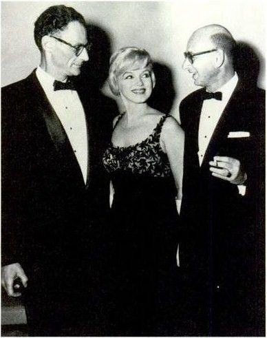 """On September 27, 1959, at the Bellevue Stratford Hotel in Philadelphia, Marilyn and Arthur Miller attend a charity event in honor of """"The American Friends of Hebrew University"""" in the company of Rabbi Robert Goldburg."""