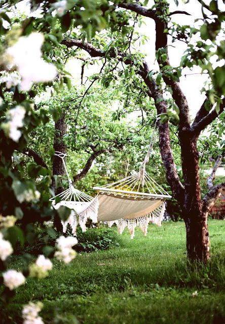 I am ready to just lie on this white shabby chic lace hammock and enjoy spring and summer.  gorgeous - a post full of inspirational backyard home decor ideas.