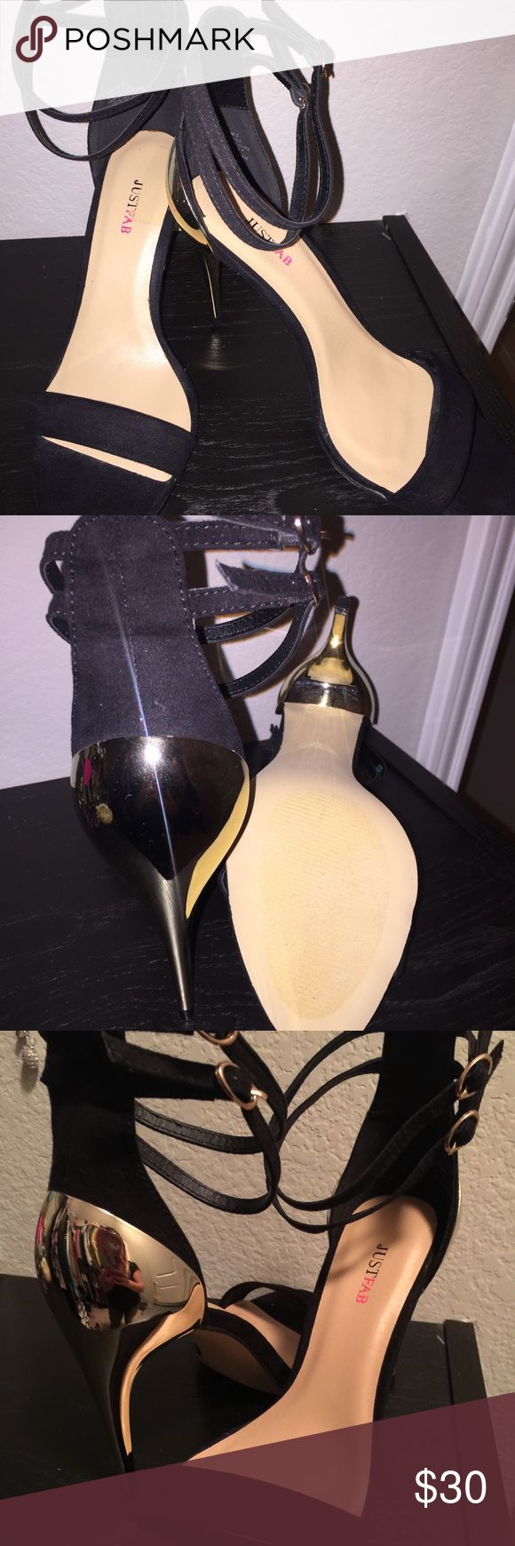 """Sexy black and gold strappy sandals Never worn - Very sexy black and gold sandals. They have a double ankle strap and gold 4"""" heel. A definite wardrobe stable! JustFab Shoes Sandals"""