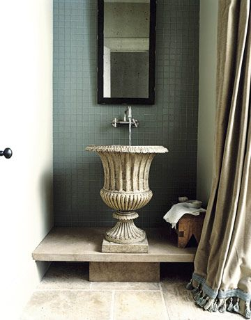 Natural Powder Room                                                 Project manager Scott Torode found the Robinson Iron garden urn and reinvented it as a powder room sink.