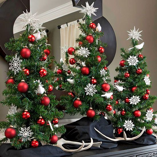 Traditional Tabletop Christmas Trees. I like this idea for the top of my buffet.