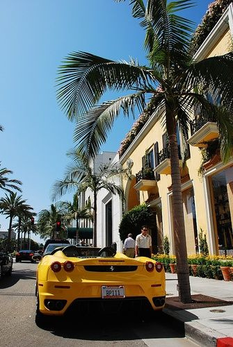 Same Yellow Ferrari F430 under a palm Tree on Rodeo Drive in Beverly hills