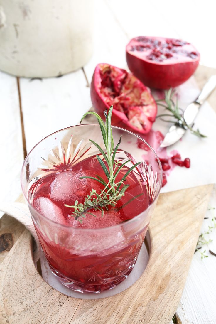 Pomegranate Gin - Pomegranate Juice and Seeds Tonic Heinrichs Gin Rosemary/ thyme Ice cubes