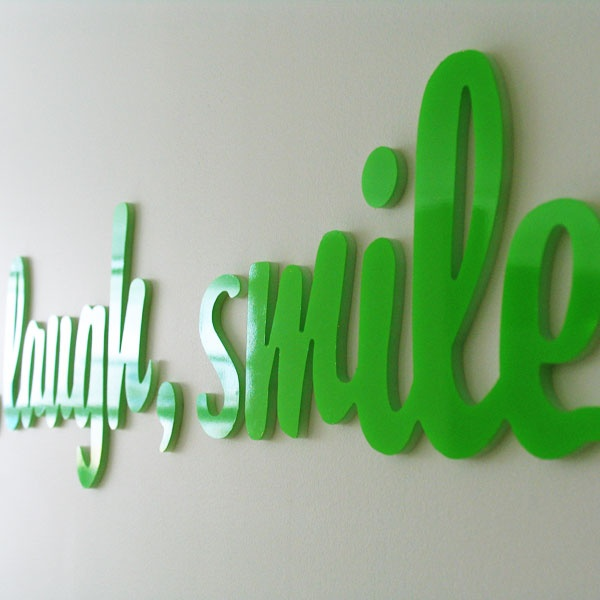Tagline development by Neon Zoo was set up as 'in clinic' signage for Smilehouse Orhtodontics.