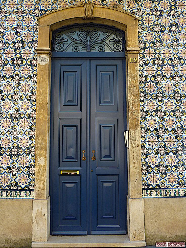 Door in a tiled wall with portuguese azulejos, Coimbra-Portugal (Photo © Doors Portugal)