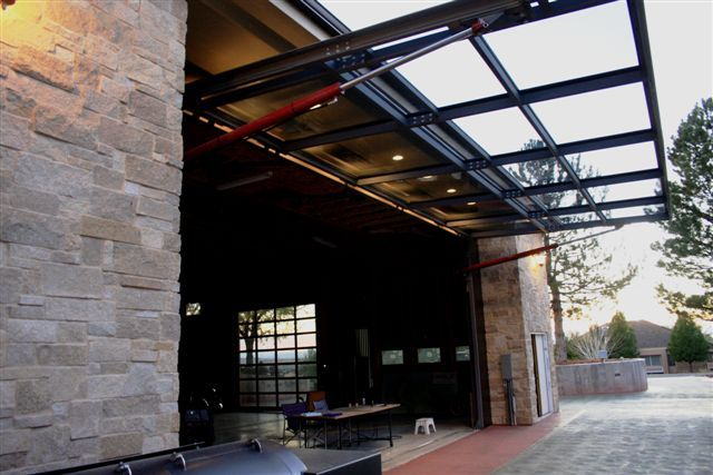 32.3 A building contractor in Denver, Colorado decided to put a custom-made Schweiss glass garage and patio door on his home. He wanted to maintain at least a 30.5' x 13.10' opening. Heavy-duty cylinders open the door straight and quickly and seal it tight against all weather conditions. The door gives him a beautiful outdoor view and is ideal for entertaining during family gatherings.