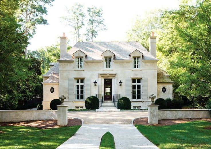 Stanley Dixon & Betty Burgess  Atlanta Homes Mag    Gorgeous French stone home exterior with gray shingle roof.