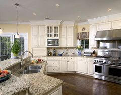 Off white cabinets with white trim and pale Yellow walls