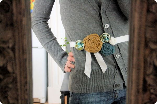 A bundled group of funky flowers makes a fun belt when pinned to a grosgrain ribbon.