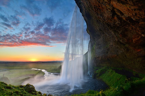 ragingcurrents:    Seljalandsfoss Siren Sunset by David Shield Photography on Flickr.