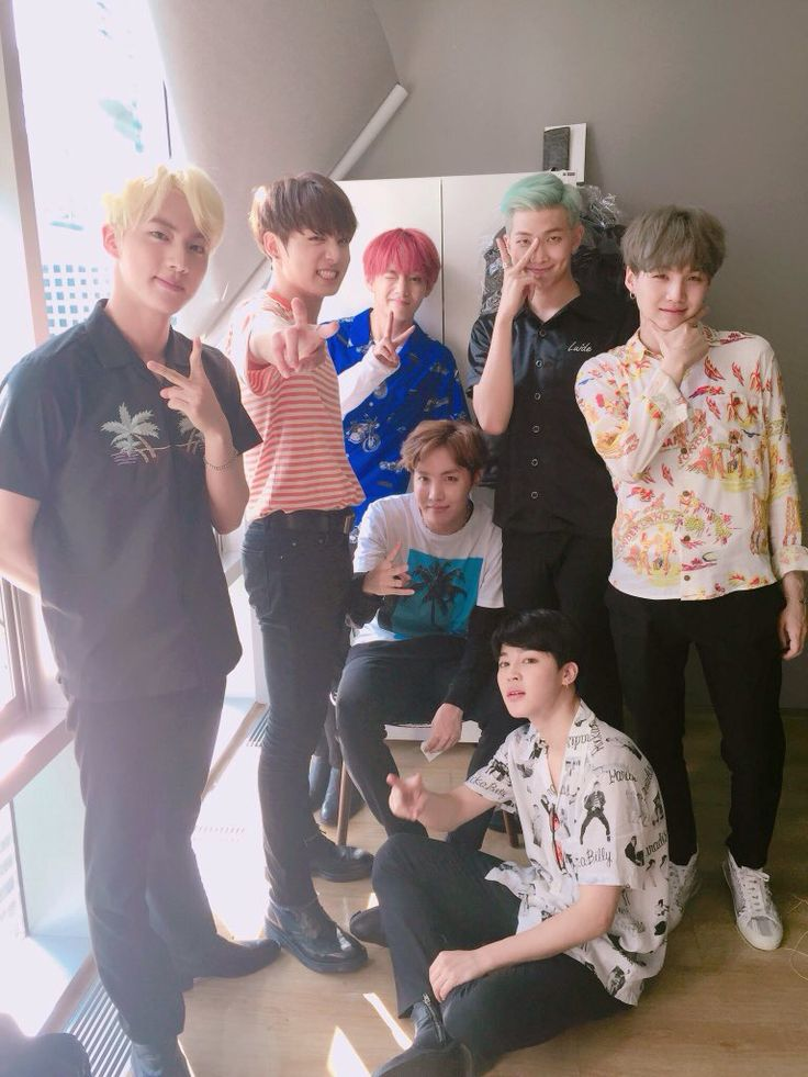 All of them are doing peace signs but suga is like ef this.