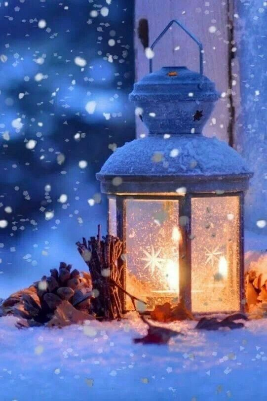 Lantern surrounded by snowfall