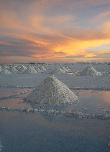 Salar de Uyuni, Bolivia. The world's largest salt flat at 10,582 square kilometers. Formed as a result of transformations between several prehistoric lakes. The Salar serves as a major breeding ground for several species of pink flamingos.