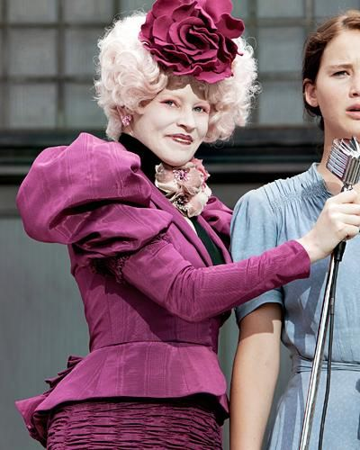 Look Back at Effie Trinket's Most Outrageous Looks from The Hunger Games - Magic in Magenta from #InStyle