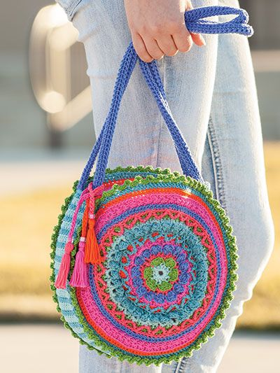ANNIE'S SIGNATURE DESIGNS: Mandala Bag Crochet Pattern designed by Lena Skvagerson for Annie's. Order here: https://www.anniescatalog.com/detail.html?prod_id=136500&cat_id=2401