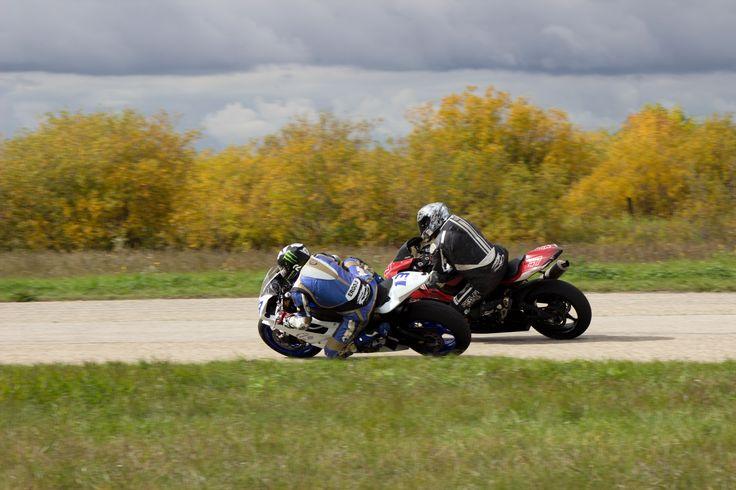 Motorcycles racing in turn 3 at Gimli MotorSport Park - passing