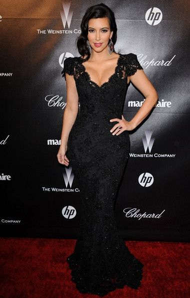 Kim Kardashian in a very classy Bruce Oldfield gown. I love black, and Kim Kardashian is known for having a curvy body, which I think is super sexy and every woman who has one should definitely embrace it!
