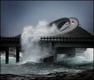 The Atlantic Road in Norway; Many tourists choose to travel to the Atlantic Road during the autumn to experience the raging storms that pound the road. The construction workers experienced 12 hurricanes during the building process before the road opened in 1989.; um, YES!!!